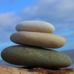 Three pebbles balancing